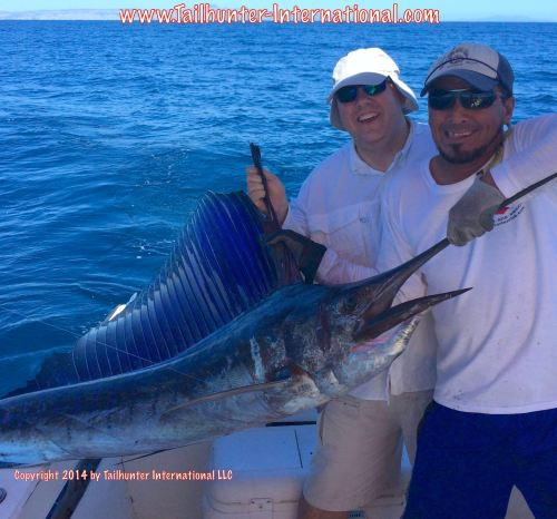 Nash Johnson tags small sailfish 10-14