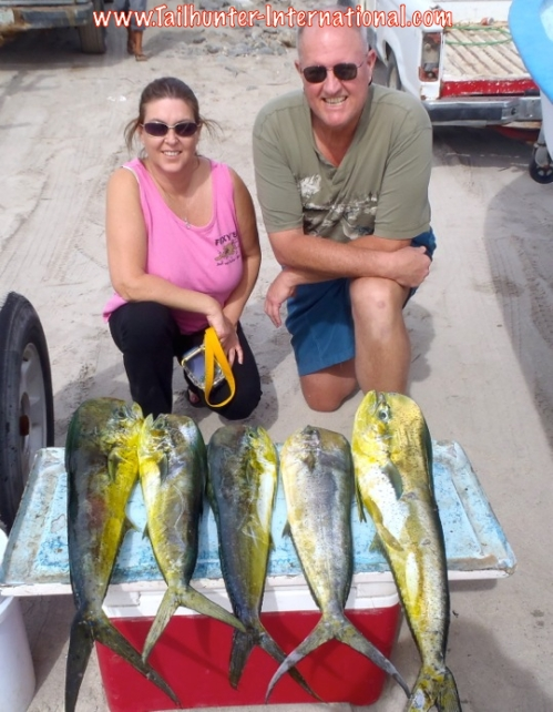 Tracey and Brian Campbell tags small dorado 12-14