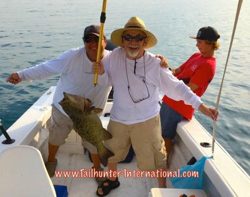 """Fun photo with Orhan Gurbuz and popular Captain Rogelio """"Jolly Roger""""  Camacho and a nice cabrilla near Espirito  Santo Island."""