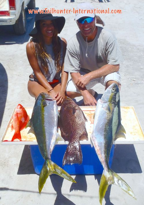 Jasmine and Mark Bonsack from Seattle show off a nice rack of fish including some good yellowtail; a big cabrilla and a snapper after a nice day out've Bahia de los Muertos with Tailhunter Sportfishing in La Paz.