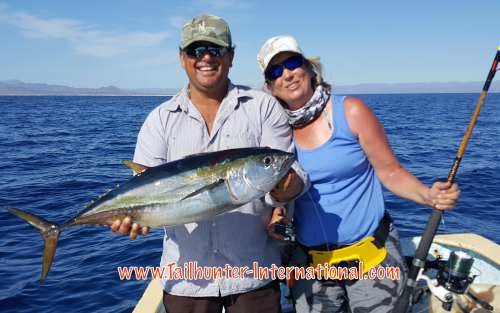 Shelley Reeve from Wyoming with her favorite captain Armando and another nice yellowfin tuna on light tackle!