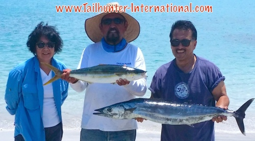 Captain Jorge with Jeff and Marianne Sugawara and another wahoo plus a rainbow runner, cousin to yellowtail, which is a cooler water fish.
